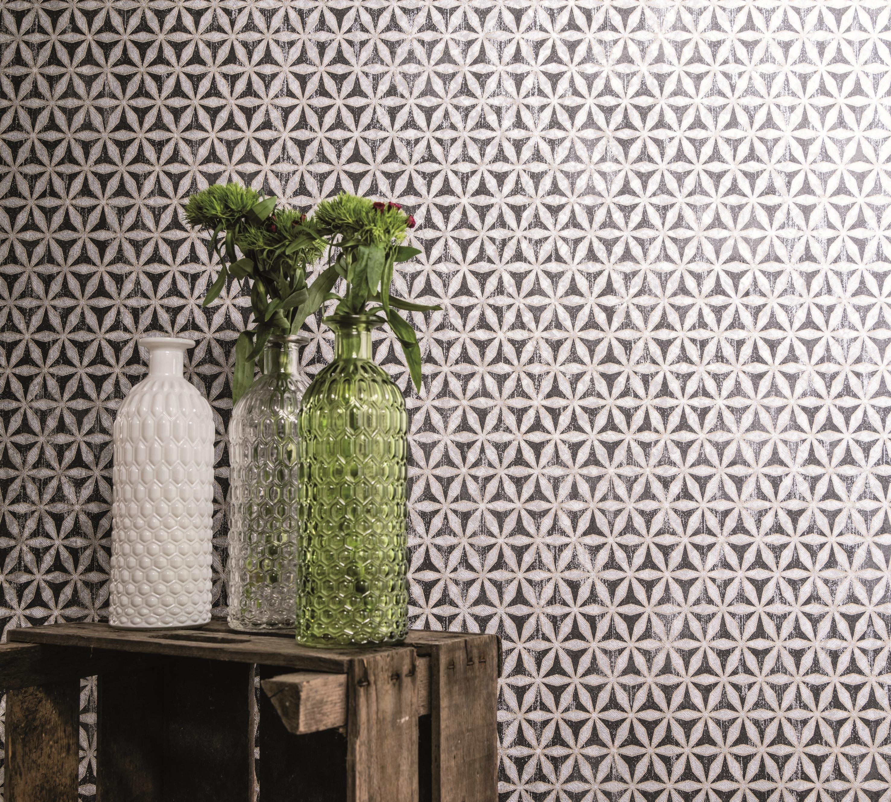 Papier peint avec de petites formes géométriques en noir et blanc