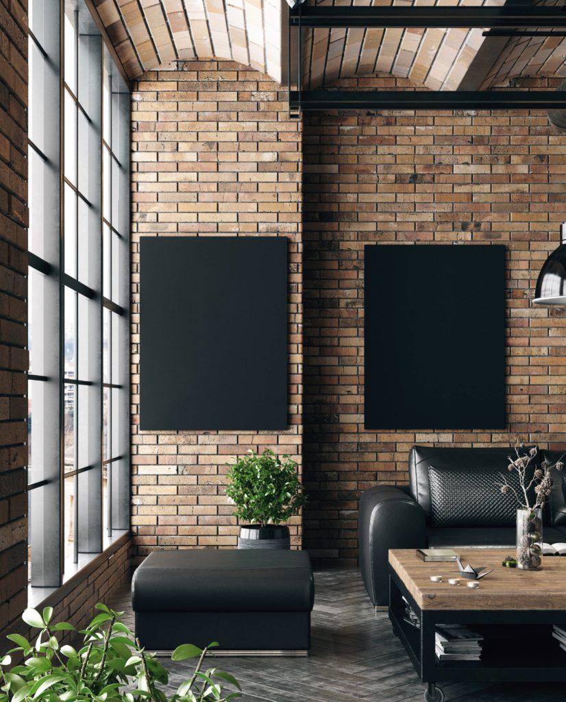 Salon de style industriel aux couleurs sobres, avec un banc en cuir noir comme accessoire déco